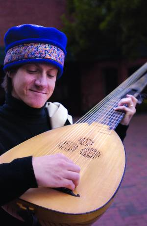 David Rogers wearing blue hat, playing mandolin